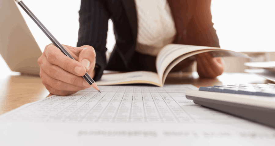accountant looking over year-end checklist